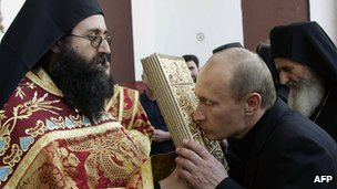 Russian President Putin kisses icon on a visit to Mt Athos, 10 Sep 05