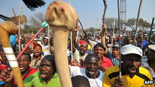 September 2012 file picture of thousands of miners of South Africa's strike-hit platinum industry at a rally in Rustenburg