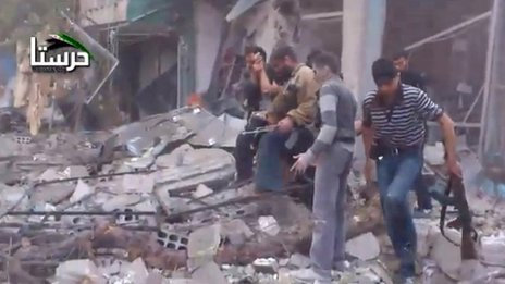 Video posted online by opposition activists purportedly showing rebel fighters searching for survivors after an air strike in Harasta, Damascus (29 October 2012)