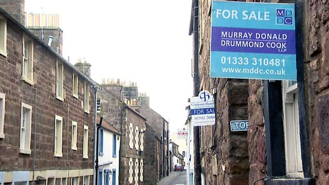 'For sale' signs on houses