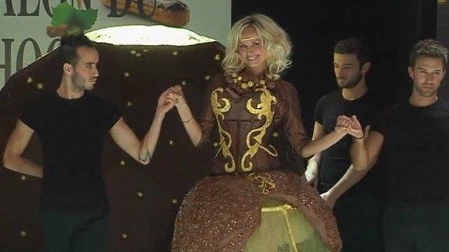 A model wearing a chocolate dress