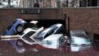 Cars piled on top of each other at the entrance to a garage on South Willliam Street in Lower Manhattan