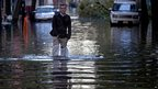 A resident walks on a flooded street in Hoboken, New Jersey. Photo: 31 October 2012