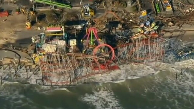 Aerial footage of funfair washed out to sea on the east coast of the US