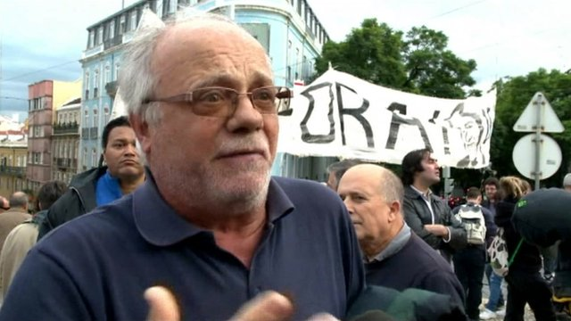 Man protesting outside Portuguese Parliament