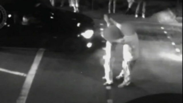 Police footage of man and boy starting car race