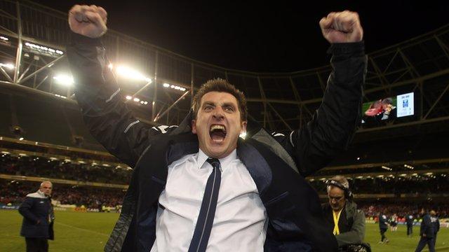 Declan Devine celebrates at the final whistle