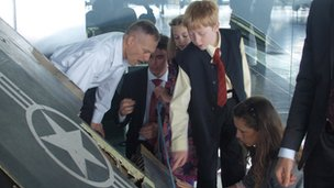 Dale Zelko shows his and Zoltan Dani's children the wreckage of his stealth plane