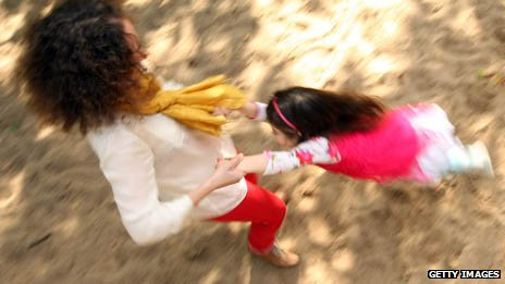 Woman plays with daughter