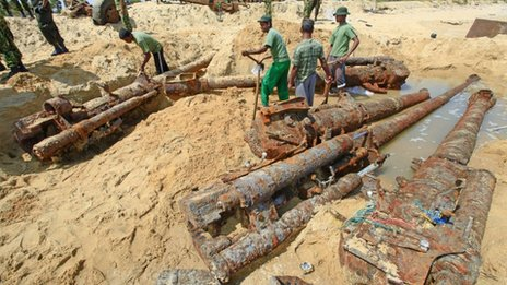 Sri Lankan army soldiers dig out heavy weapons, which they said were buried by the Liberation Tigers of Tamil Eelam (LTTE) at the end of the three-decade war against Sri Lanka troops in 2009