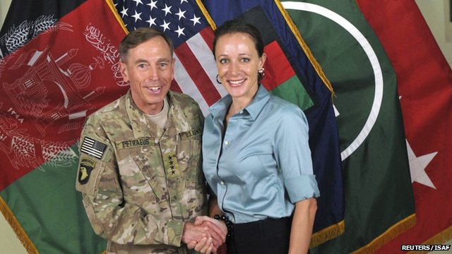 General David Petraeus shakes hands with author Paula Broadwell in July 2011