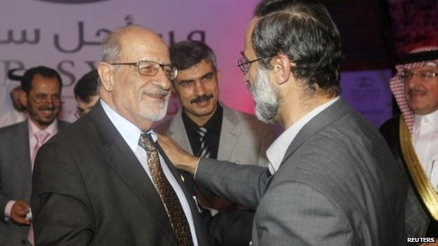 Haitham al-Maleh (left) shakes hands with Moaz al-Khatib in Doha (11 November 2012)