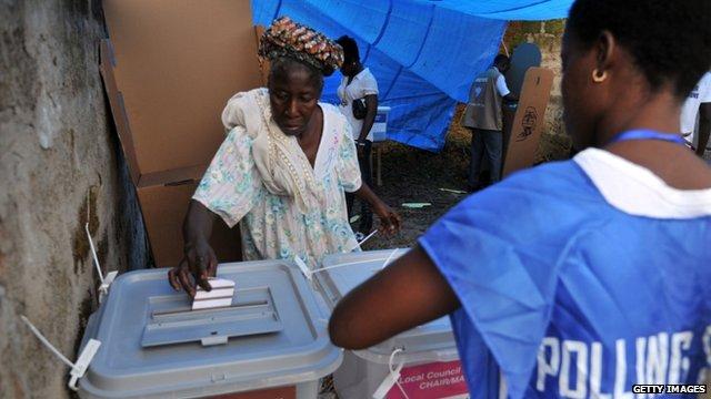 Woman votes in Sierra Leone