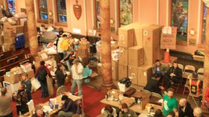 Volunteers and supplies in the Occupy Sandy donation centre