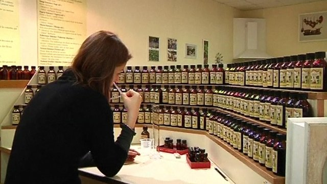 Woman smelling perfumes