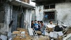 Palestinian boys stand next to the badly damaged house of Hejazi family after what Hamas health ministry said was an Israeli air strike in the northern Gaza Strip