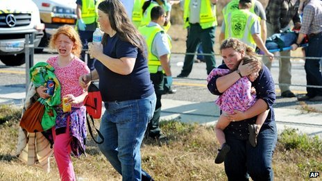 A family walks away from the pile-up on Interstate 10 in Texas on 22 November 2012