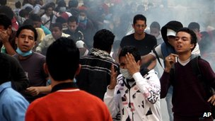 Protesters affected by tear gas near Tahrir Square