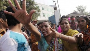Workers shout slogans as they protest against the death of their colleagues after a devastating fire in a garment factory which killed more than 100 people, in Savar November 26, 2012.
