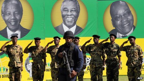 Former ANC soldiers in front of portraits of Nelson Mandela, Thabo Mbeki and Jacob Zuma in Bloemfontein South Africa (January 2012)
