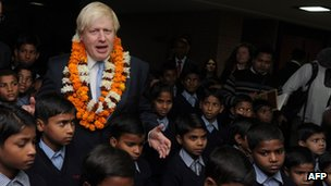Mr Johnson with schoolchildren at Amity University