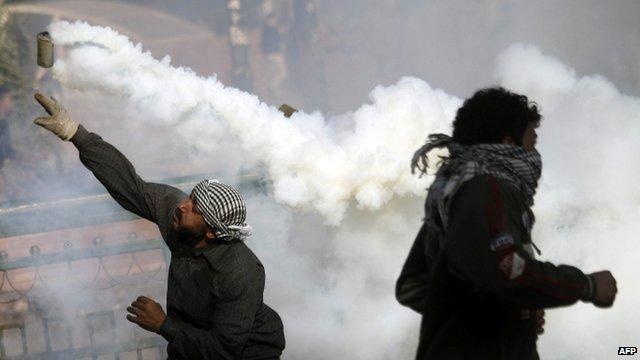 Protesters throw tear gas