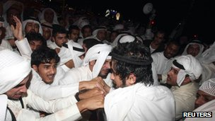 Demonstrators clash with police during an anti-government protest in front of parliament in Kuwait City (15 October)
