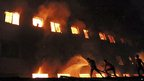 Firefighters battle a fire at a clothes factory outside Dhaka