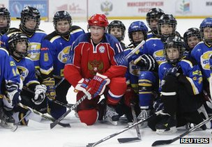 Russian President Vladimir Putin (in red) at an ice hockey match, 15 March 2011