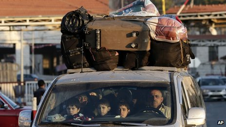 A Syrian family crosses into Lebanon at the border crossing in Masnaa, eastern Lebanon, 30 November 2012
