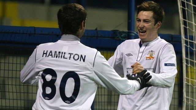 Glenavon manager Gary Hamilton celebrates with goalscorer Andy McGrory