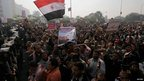 Supporters of President Morsi shout slogans in front of riot police at the Supreme Constitutional Court in Cairo - 2 Dec 2012