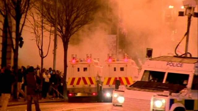 Police vans attend rioting in Belfast