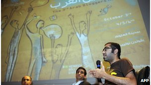 Saudi Arabian blogger Ahmed Al Omrane (right) speaks during the third Arab Bloggers Meeting on 3 October 2011, in Tunis.