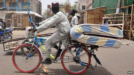 Cyclist in Kano, Nigeria