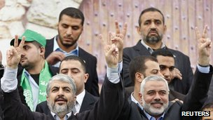 Hamas chief Khaled Meshaal (L) and senior Hamas leader Ismail Haniyeh flash victory signs upon arrival at a rally marking the 25th anniversary of the founding of Hamas, in Gaza City