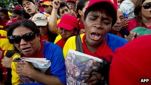 "Supporters of Venezuela""s President Hugo Chavez rally in Caracas on 9 December 2012."