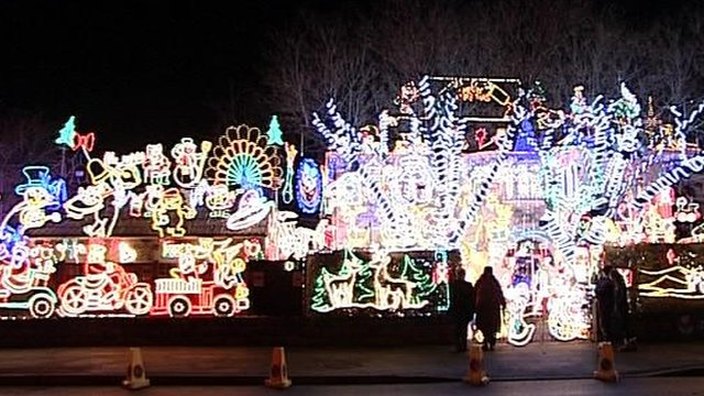 House and grounds covered with Christmas lights at Melksham, Wiltshire