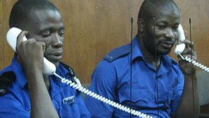 Two disabled policemen on the phone in Sierra Leone (December 2012)