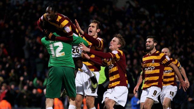 Bradford City players celebrate victory over Arsenal
