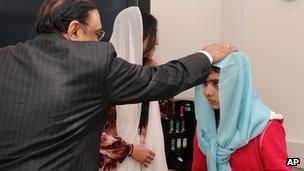 Malala Yousufzai being visited by Pakistani President Asif Ali Zardari in the UK on 8 December 2012