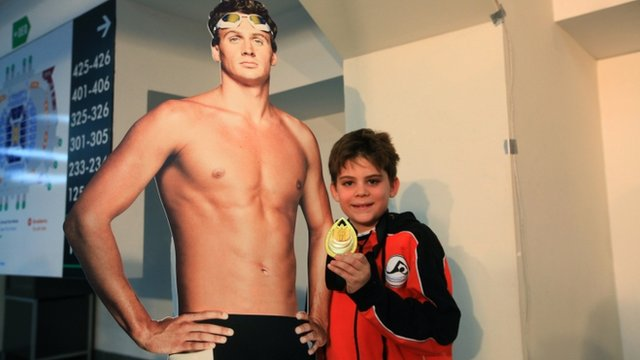 Ryan Lochte fan with his gold medal