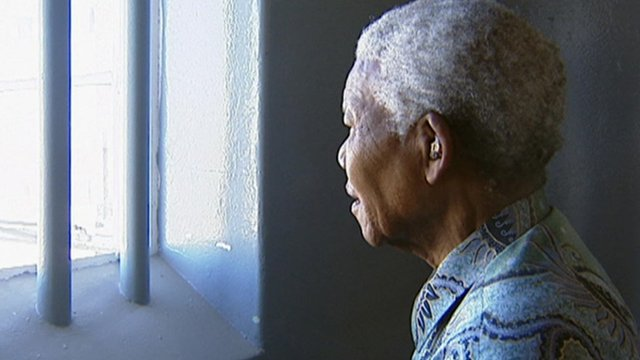 Mandela looks through prison bars