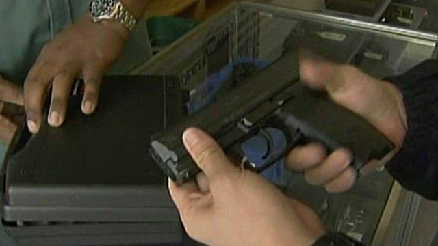 Hands holding a gun