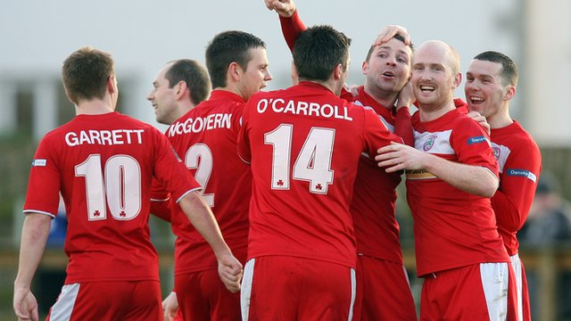 Cliftonville players celebrate Marc Smyth's second goal against Ballinamallard