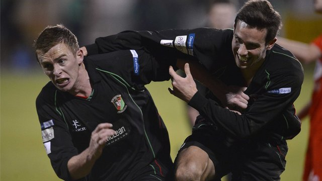 Glentoran's Jay Magee and Andrew Waterworth celebrate the victory over Portadown