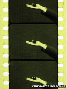 Roll of film showing someone holding a black ball