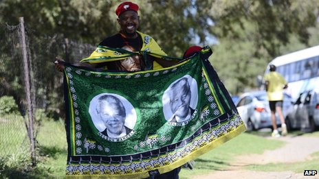 A street vendor sells African National Congress (ANC) wraps with portraits depicting former South African President Nelson Mandela prior to the opening of the 53rd National Conference of the ANC on 16 December 2012