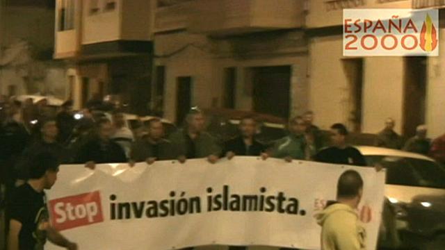 Espana2000 members hold a banner