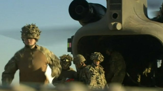 British soldiers and helicopter in Afghanistan
